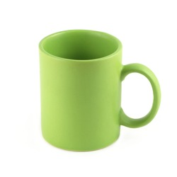 Green empty tea or coffee cup isolated on white closeup