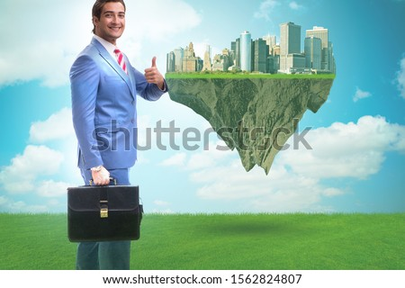 Green energy anc ecology concept with businessman #1562824807