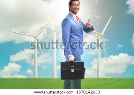 Green energy anc ecology concept with businessman #1570142650