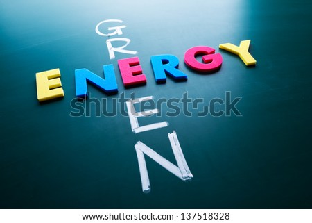 Green energy concept, colorful words on blackboard