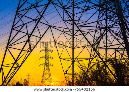 Green energy concept, Electricity station, Close up high voltage power lines at sunset. electricity distribution station. high voltage electric transmission pylon silhouetted  tower.