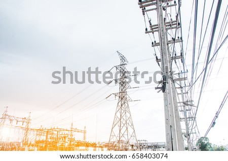 Green energy concept, Electricity station, Electricity plant landscape over blue sky. Part of high-voltage substation with switches and disconnectors.