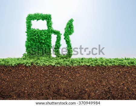 Green energy concept with grass growing in shape of fuel pump  #370949984