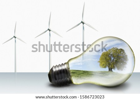 Green Energy Concept With Nature Landscape In Lightbulb