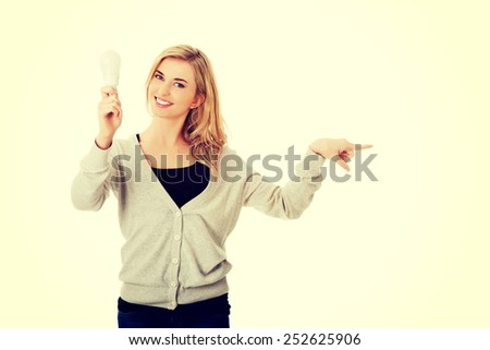 Green energy concept. Woman with led light bulb showing copy space.
