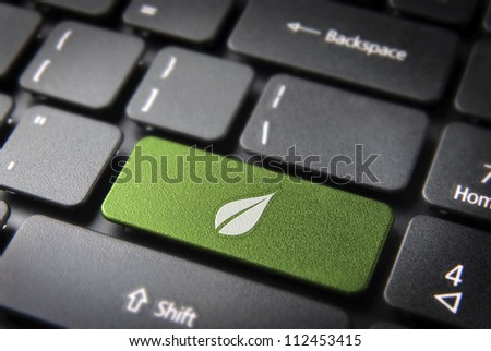 Green energy key with leaf icon on laptop keyboard. Included clipping path, so you can easily edit it.