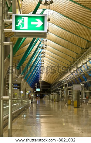 Green exit sign on airport