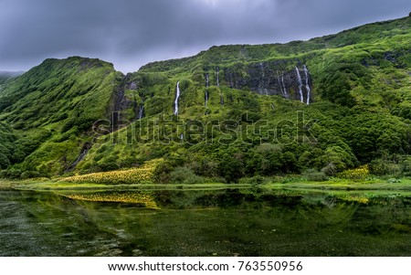Shutterstock Green exotic waterfall laguna witch Flores, Azores