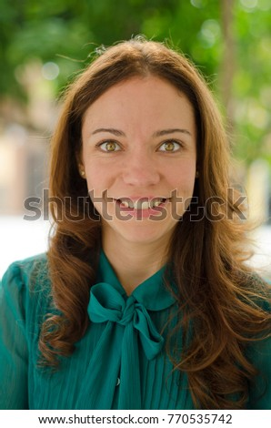 Green eyed woman looking at camera in close up portrait