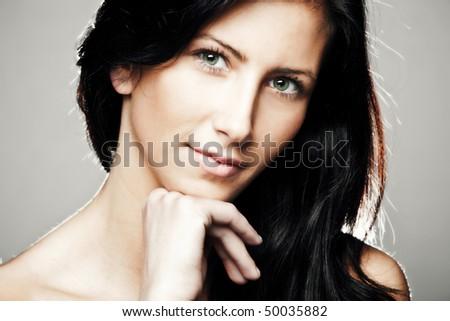 green eyes black hair young woman beauty portrait, studio shot
