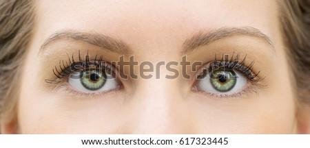 Green eyes of beautiful young girl