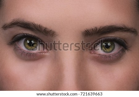 Green eyes of beautiful young girl - Shutterstock ID 721639663