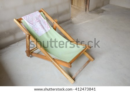 green fabric chair in room #412473841