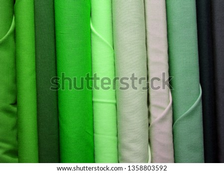 green  fabric for sale in the textile and textile shop #1358803592