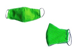 Green Fabric mask handmade has white dot on white background to protect Covid-19 and pm2.5