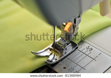 Green fabric on a sewing machine