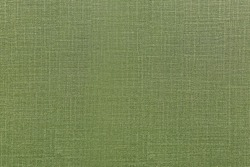 Green fabric texture surface for interior wall design. Olive color seamless textile for nature of peace feeling for architecture or construction of hotel or fancy restaurant.