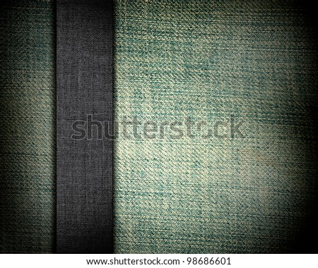 green fabric texture with dark grey canvas strap as background for insert text or design
