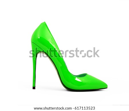 green female shoes on high heels isolated on white background #617113523