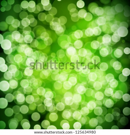 Green festive background. Elegant abstract background with bokeh defocused lights.