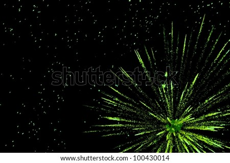 Green festive fireworks in colorful shades of lime and green