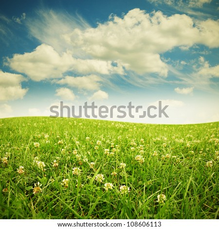 green field and blue sky, nature background