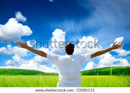 green field and happy young man