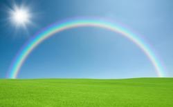 Green field and rainbow