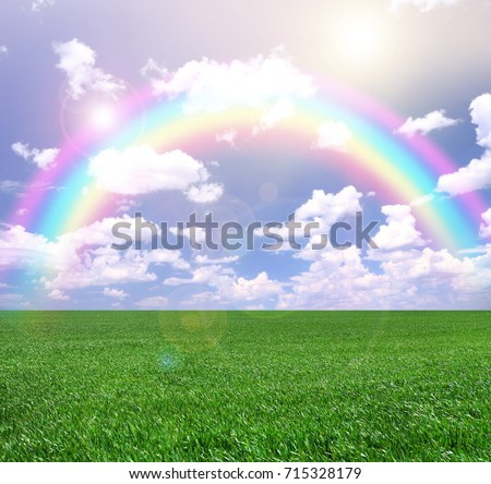 Stock Photo Green field and rainbow in sky