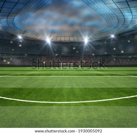 green field in soccer stadium. ready for game in the midfield