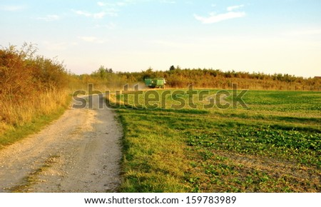 green field in the Czech Republic with tractor #159783989