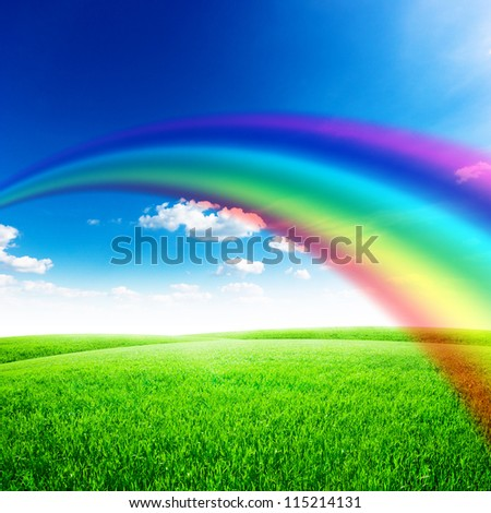 Green field under blue sky with sun and rainbow. Beauty nature background