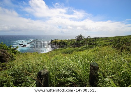 Green fields and an old church overlooking the ocean on Maui