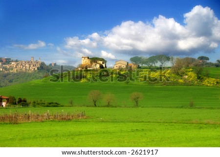 Green fields and hills of Tuscany at spring in Italy.