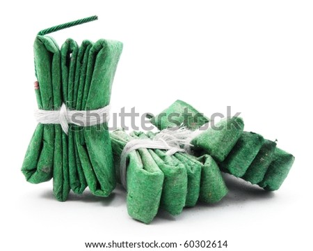 green firecracker isolated on white background showing new year concept