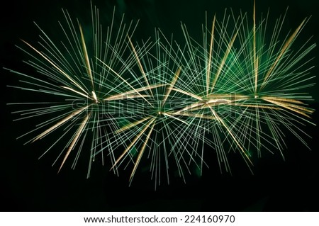 Green fireworks background,explosion close up in dark background, green fireworks texture,