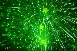 Green fireworks in the night sky. Festive firecracker. Beautiful background