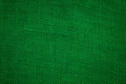 Green flax texture. Pure linen sack cloth textile background. Green raw organic fabric bag patter. Green Christmas background