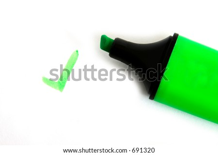 "Green fluorescent pen with a ""tick"" written on a white background - stock photo"