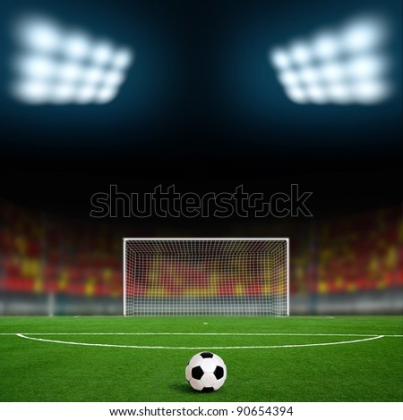 Green football ground against the sky