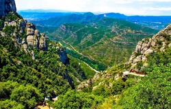 Green forests on the rocks in the mountains.Mountain valley panorama. Mountain green canyon top view panorama