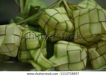 Green fresh Ketupat or Rhombus for Eid Mubarak / Idul Fitri Hari Raya Ramadan #1113758897