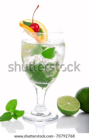 Green Fresh Mojito cocktail with light rum, vodka, gin, limes, spring of mint, simple soda, orange, maraschino cherry and syrup in cocktails glass on a white background - stock photo