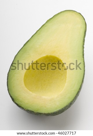 green fresh raw avocado half on  white background