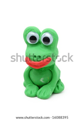 Green frog made from child's play clay isolated on white background