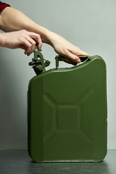 Green fuel container jerrycan isolaed.canister for gasoline, diesel gas.Fire resistant storage tank.