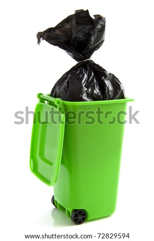 Green garbage box with plastic bag isolated over white