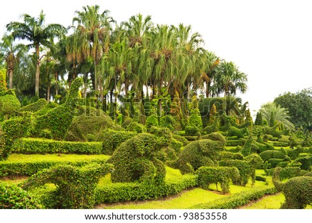 Green Garden With Animal Shaped Bushes Design