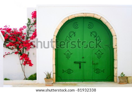 Green gate in Arabic style.