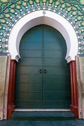 Green gateway to the mosque, Morocco. Traditional Moroccan style design of an entry door